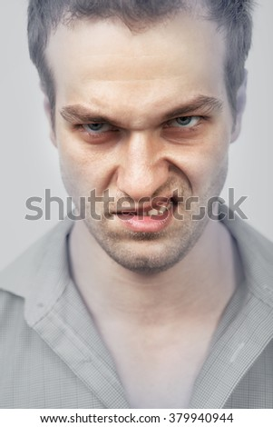 Face of evil angry scary man - stock photo