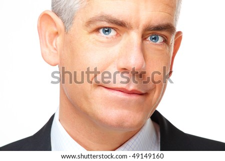 Face of gently smiling mature business man, isolated over white background