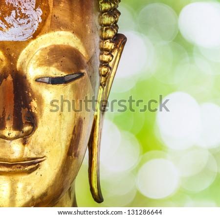 Face of gold buddha statue - stock photo