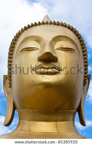 Face of gold Buddha  statue close-up