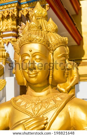 Face of golden Brahma statue at Thai temple, Thailand