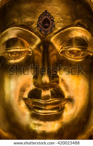 Face of golden buddha sculpture, Thailand - stock photo