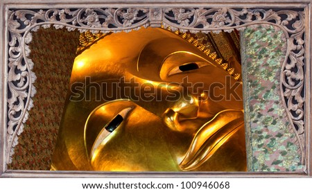 Face of goldent big buddha in the wooded picture frame. Wat prakeaw, collection of best travel place in Thailand. - stock photo