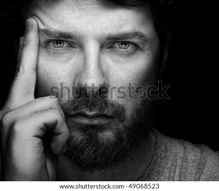 Face of handsome bearded confident young guy - stock photo