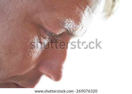 Face of handsome young man close up portrait on gray background - stock photo