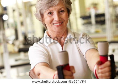 Face of happy athletic woman in gym - stock photo
