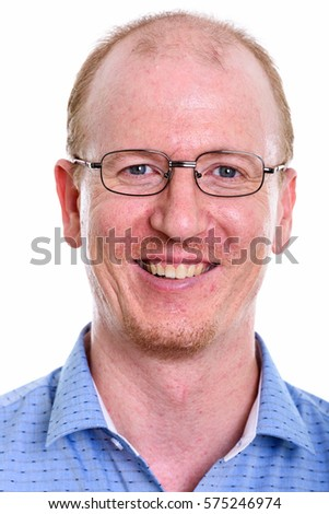 Face of happy businessman smiling while wearing eyeglasses