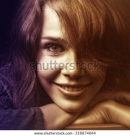 Face of happy smiling young woman with nice hair - stock photo