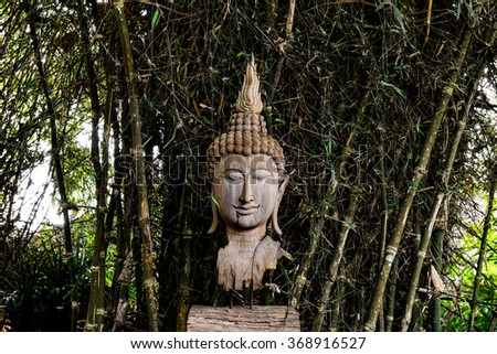 Face of Lord Buddha, native Thai style wood carving.