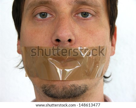 Face of  man having his mouth closed with sellotape