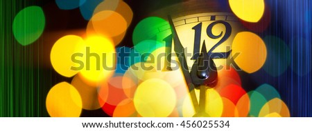 face of new year clock with colored decoration and colored stripes,