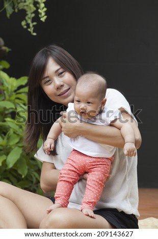 face of newborn infant with mom use for baby and motherhood healthy life style topic