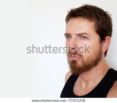 Face of pensive handsome man isolated on white - stock photo