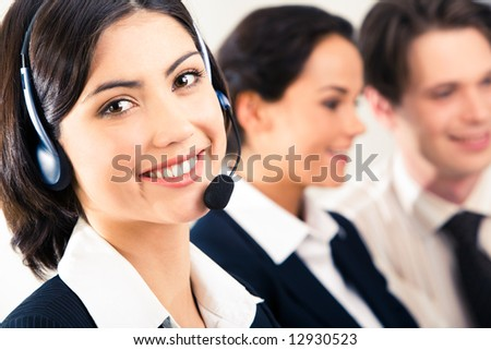 Face of pretty girl wearing headphone on the background of two speaking people - stock photo