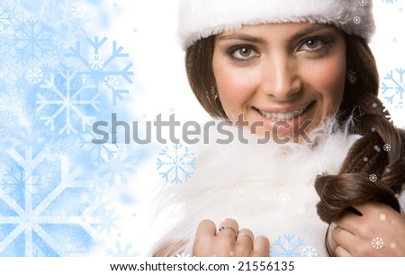 Face of pretty woman surrounded by flakes touching white fur