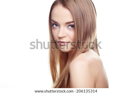 Face of pretty woman with makeup looking at camera in isolation