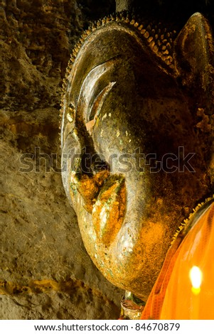Face of reclining Buddha in the cave, Thailand