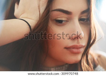 Face of sad thoughtful young teen woman with full beautiful lips