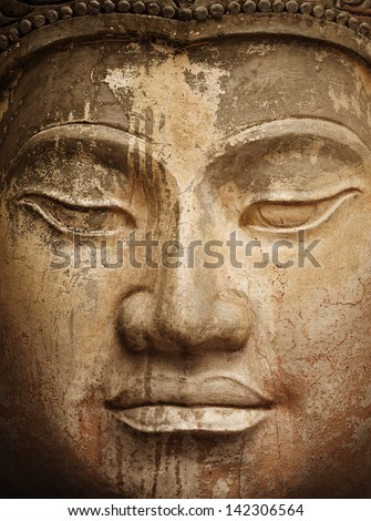 Face of the ancient stone Buddha close up - stock photo