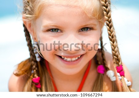 face of the beautiful girl on a beach - stock photo
