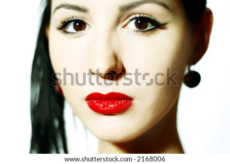 Face of the beautiful girl with red lips
