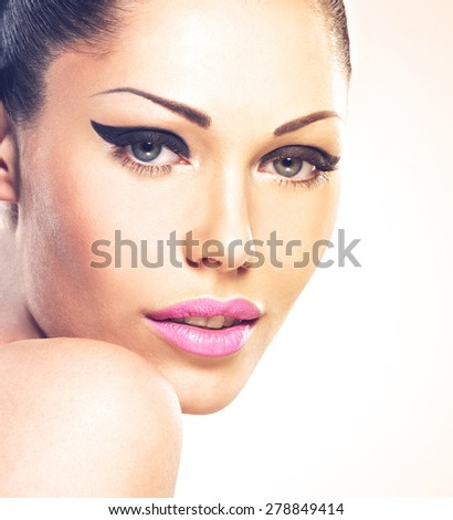 Face of the beautiful woman with fashion makeup. Sexy girl with pink lips - isolated - stock photo