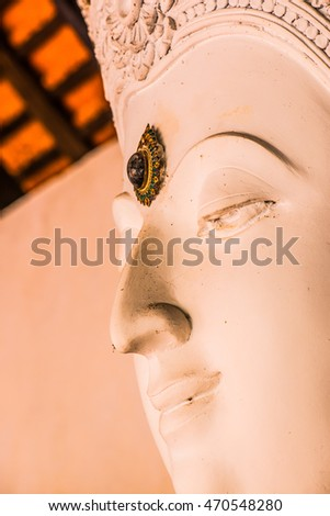 Face of white buddha sculpture, Thailand