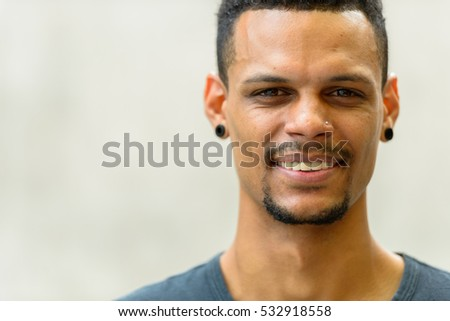 Face of young happy African man smiling