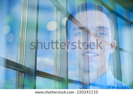 Face of young man looking at camera and window