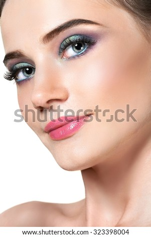 face of young woman with bright makeup. Beauty portrait