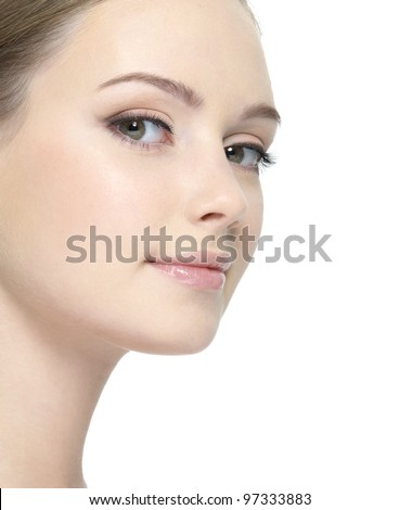 Face of young woman with clean fresh skin close-up - isolated on white - stock photo