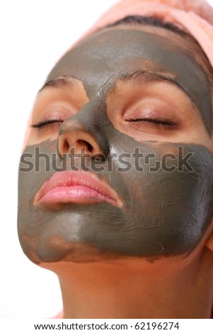 Face of young woman with mud mask on it. - stock photo