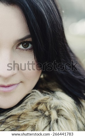 Face part of beautiful woman, half of face, in a  fur coat.  Portrait close up