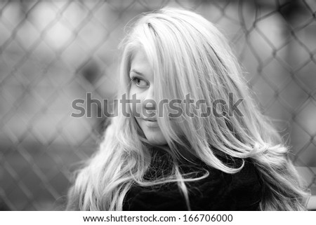 face portrait of a beautiful blonde in autumn winter coat