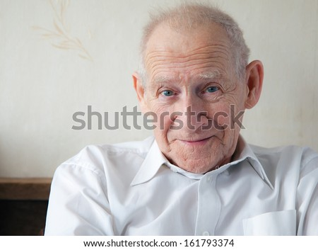face portrait of a joyful smiling senior man - stock photo