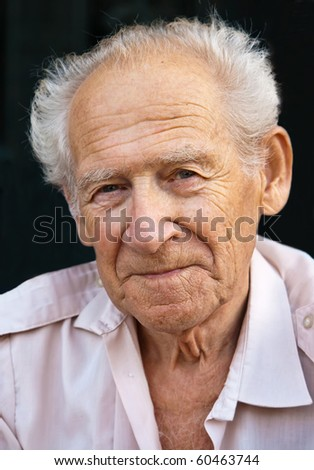 face portrait of a senior man on a black background