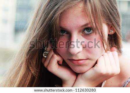 face portrait of sad young girl - stock photo