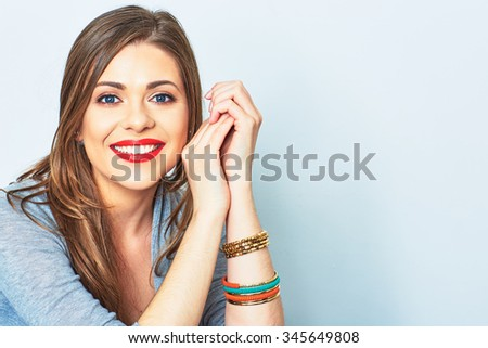 Face portrait of smiling girl. Female model studio portrait. - stock photo