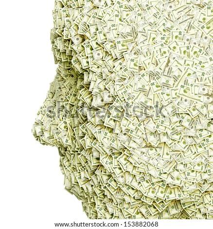 Face-shaped pile of money. - stock photo