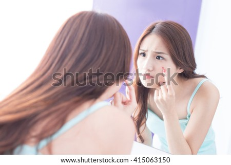 Face Skin Problem - skin care woman unhappy touch her acne and look mirror. asian beauty - stock photo