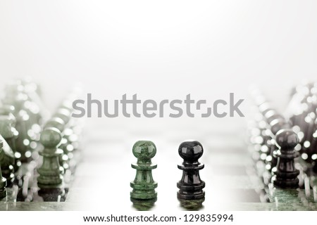 Face to face like wall and axe. First move: two pawns opposition in the middle of the board. - stock photo