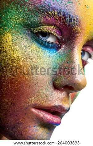Face with colorful makeup closeup