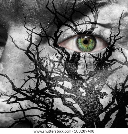 Face with green eye painted with medusa like tree - stock photo