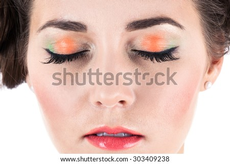 face with makeup on a white background