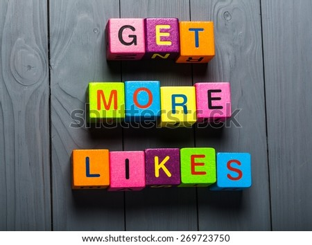 Facebook. Get More Likes card with colorful background with defocused lights - stock photo