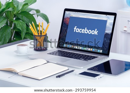 Facebook new logo on the Apple MacBook Pro Retina with an open tab in Safari browser that is on office desk. Facebook is the most popular social network in the world. Varna, Bulgaria - May 29, 2015. - stock photo