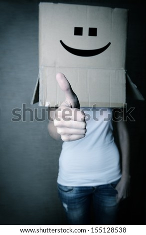 faceless girl with box on her head LIKE with thumb up, social network concept, toned - stock photo