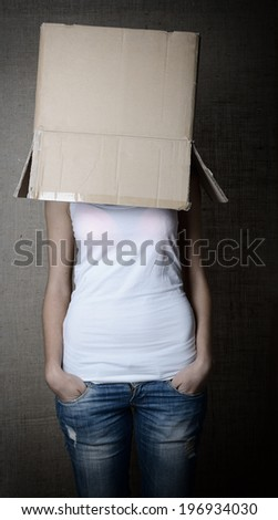 faceless girl with box on her head, toned - stock photo
