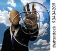 Faceless man and time spirals - stock photo