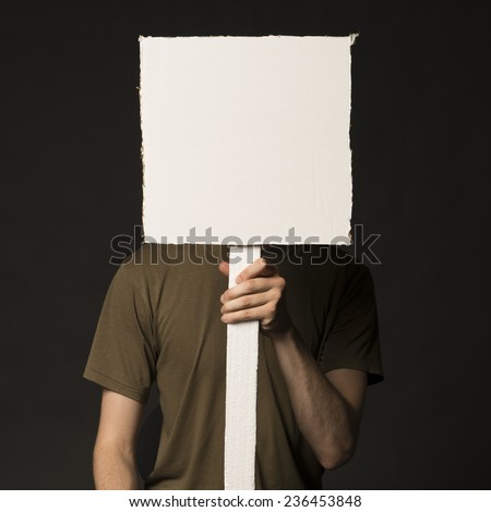 Faceless person holding a blank square sign
